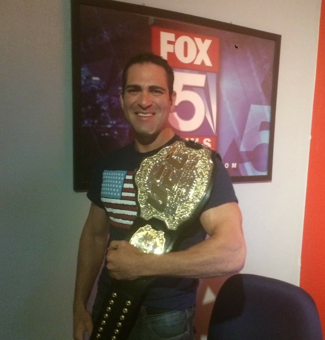 Israel Joffe with the UFC title